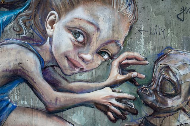 A close up reveals the amount of detail that graffiti artist Herkut have put into this street art painting of a little girl