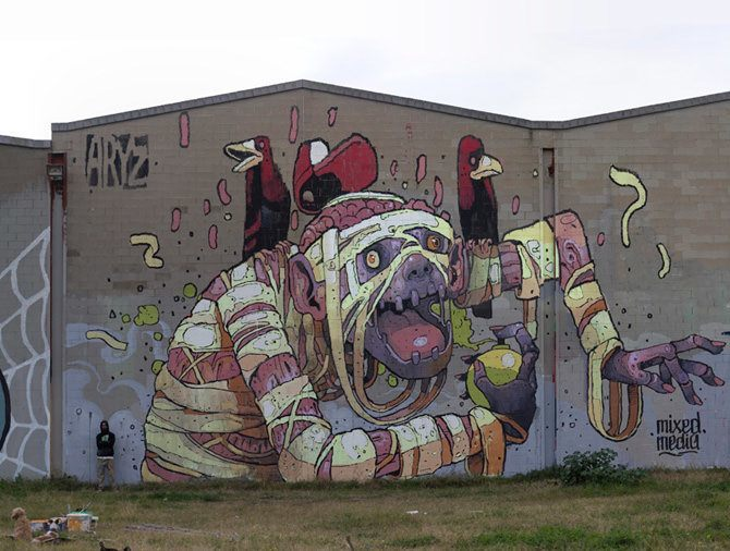 A zombie monkey sprays perfume into its armpit in this enormous graphic style street art mural by graffiti artist Aryz