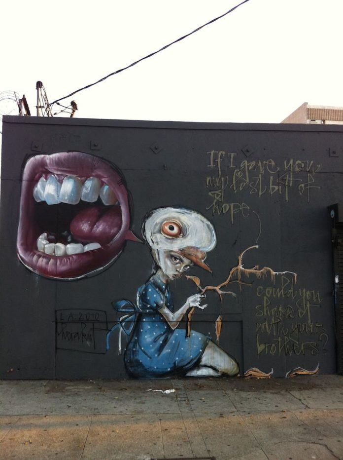 German graffiti artists Hera and Akut combine realism and abstract art in this street art painting of a girl and a screaming mouth