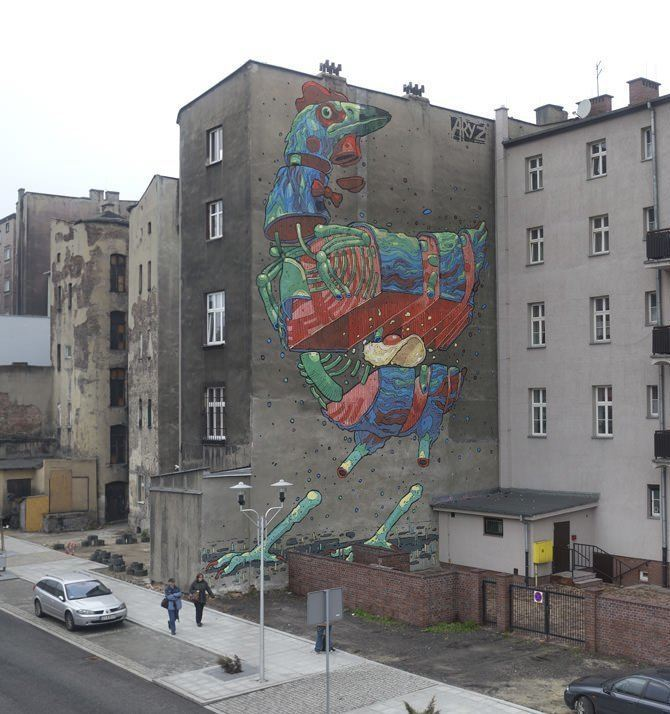 Graffiti artist Aryz paints an enormous chicken that falls to pieces, revealing a fried egg in this street art mural