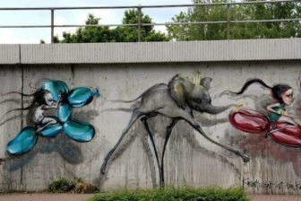 Little girls ride balloon animals past a Salvador Dali elephant in this street art painting by graffiti duo Herakut