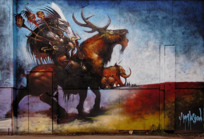 A fantasy warrior in an evil-looking helmet rides a horned beast in this graphic novel styled graffiti mural by artist Jim Vision