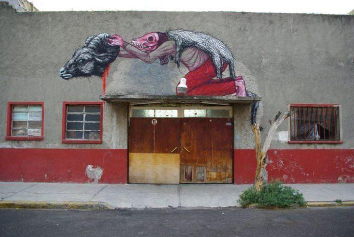 A man in ram's clothing reveals his deathly appearance in this provocative graffiti painting by Belgian street artist ROA