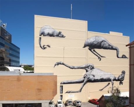 Australian animals lie suspended on this blazing hot wall in a giant street art painting by graffiti artist ROA