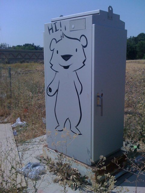 One of Phil Lumbang's friendly graffiti bears reaches out to say hi to passers by