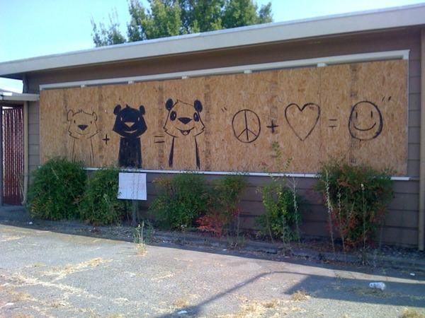 Phil Lumbang creates a friendly graffiti art work with peace, love and happiness as a message of unity and acceptance