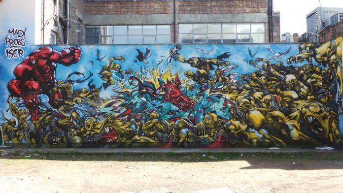 Probs joins up with other street artists to create this wall mural that creates a scene straight out of a graphic novel