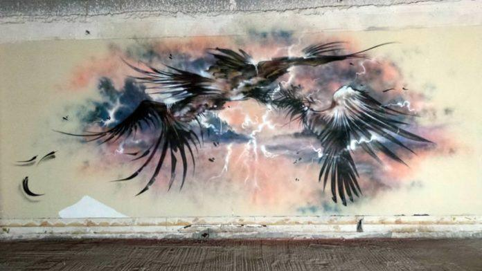 This representative street art mural by EndOfTheLine graffiti crew creates an image of angels battling in a stormy sky