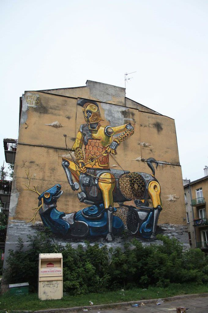 A robot knight slays a robot stag in this surreal street art work by graffiti artist Pixel Pancho