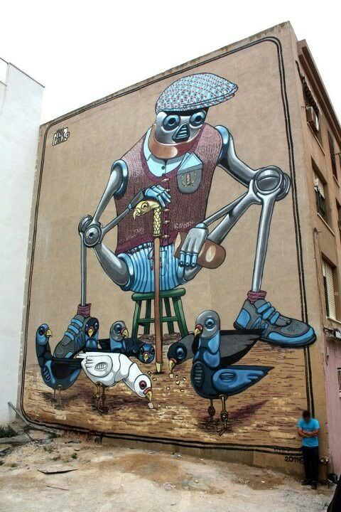 Street artist Pixel Pancho paints a robotic old man happily feeding robot pigeons
