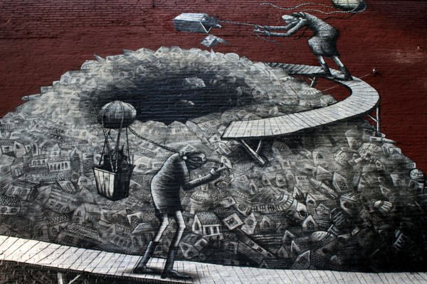 The stories told in street art by Phlegm can often be seen as a comment on modern society and economics