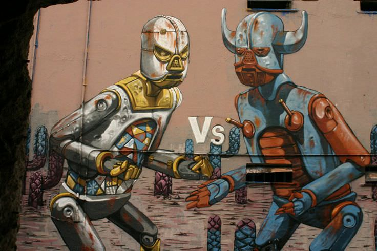 two graffiti robots prepare to fight in this street art mural by
