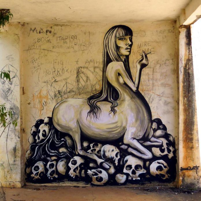 A centaur woman smokes a cigarette while perched on a pile of skulls in this social commentary painting by street artist Dinho Bento