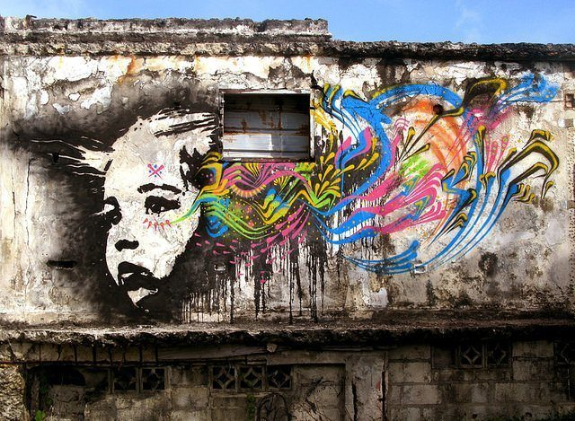 A derelict building becomes a grungy canvas for this pop art portrait by street artist Stinkfish