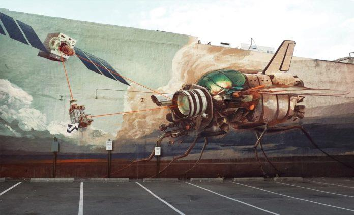 A robot housefly battles with a flying washing machine in this large scale graffiti mural by Wes21