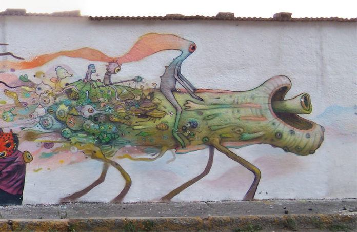 Dhear One creates an engaging street art mural with cartoon alien characters