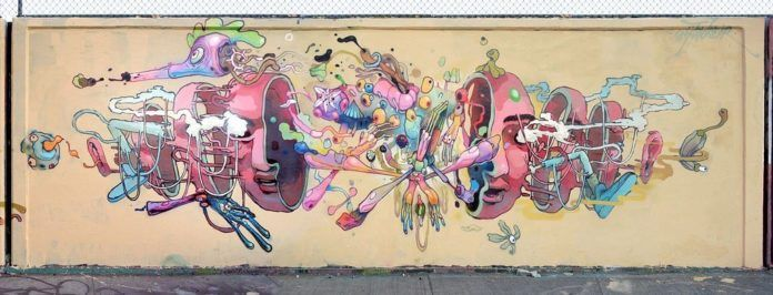 Dhear One does an autopsy on an alien creature in this colorful graffiti mural