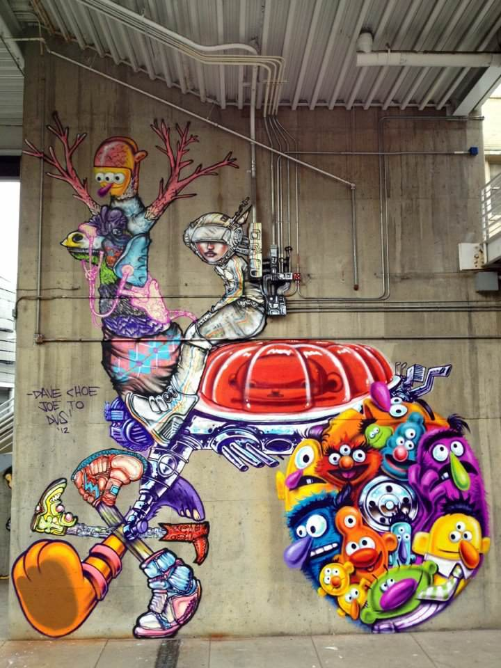 Mutant muppets and a spaceman riding a surreal cartoon animal feature in this awesome and bizarre street art painting by David Choe