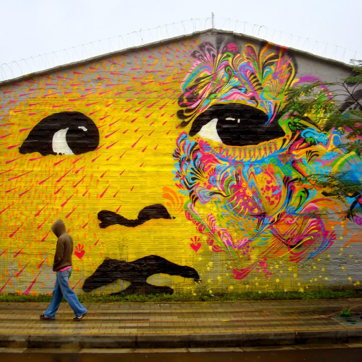 Stinkfish tranforms a portrait of a baby into a large, spiritual street art mural