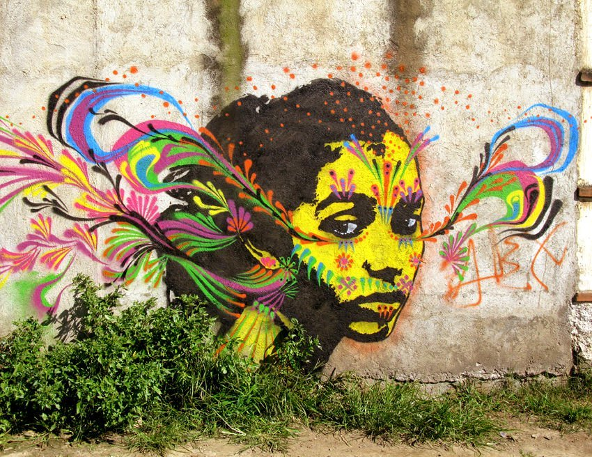 Stinkfish uses colorful designs to portray thoughts and feelings in his street art murals