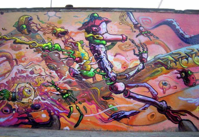 Street artist Dhear One uses bright colors and a graphic novel style to create this surreal graffiti painting