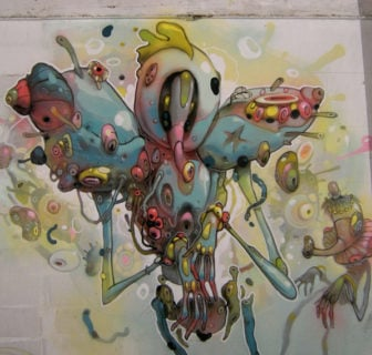 Unbelievable alien creatures find a place in Dhear One's surreal street art paintings