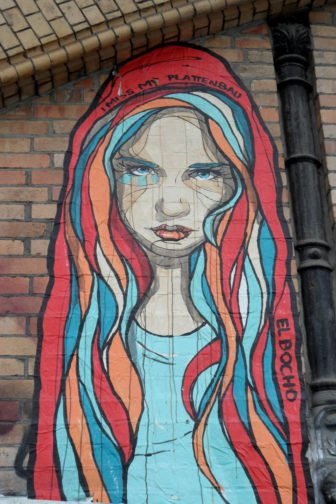 A beautiful girl empathizes with viewers who miss their home in this street art paste up by El Bocho