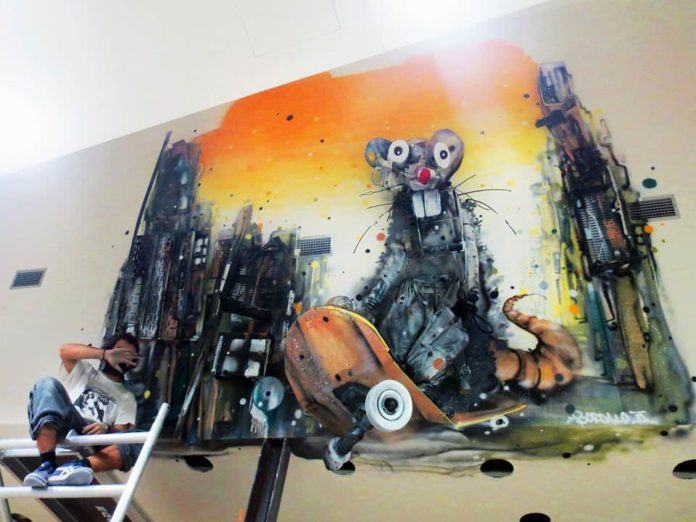 A crazy rat skateboards through a city in this sculptural street art mural by Bordalo Segundo