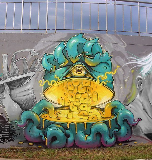 A trippy octopus shows us whats for dinner in this colorful cartoon graffiti piece by street artist Erase