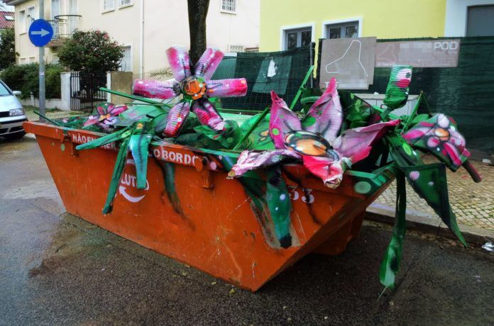 Bordalo Segundo gives a dumpster a face lift with this street art installation that transforms found objects and trash into colorful flowers