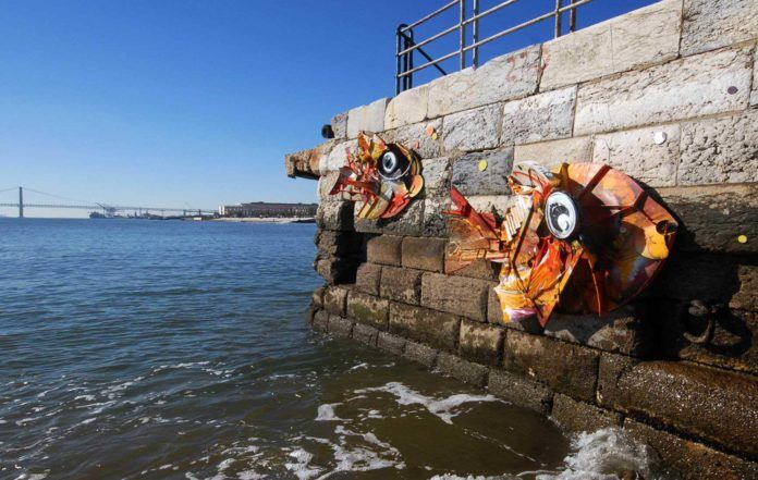 Bordalo Segundo turns garbage into attractive modern sculptures of fish and displays his art in a harbour for all to see