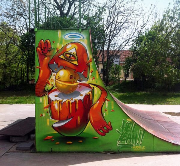 Street artist Erase adds an artistic element to this skateboard ramp with his graffiti painting of a personified egg