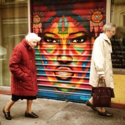 A garage door in Paris now sports a colorful portrait due to the time and effort of street artist Guache