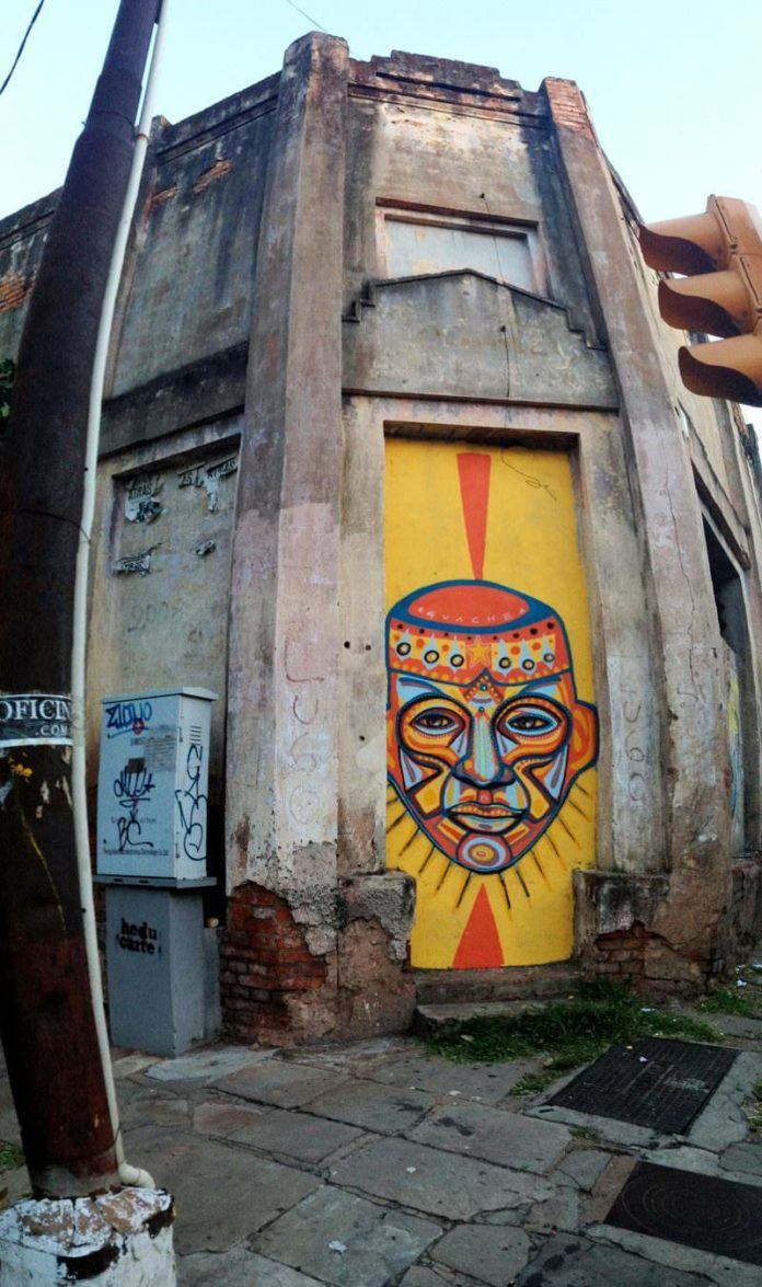 An ugly street in Paraguay gets a face lift with this street art mural by Guache