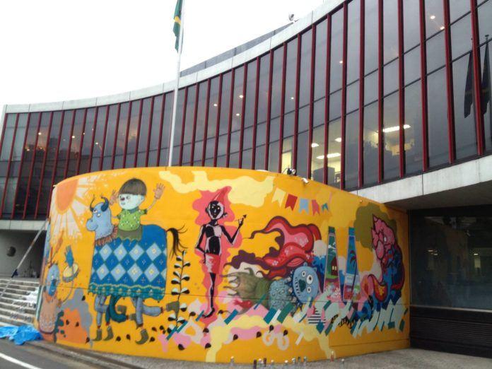 Brazilian Japanese street artist Titi Freak paints the Brazilian embassy in Tokyo