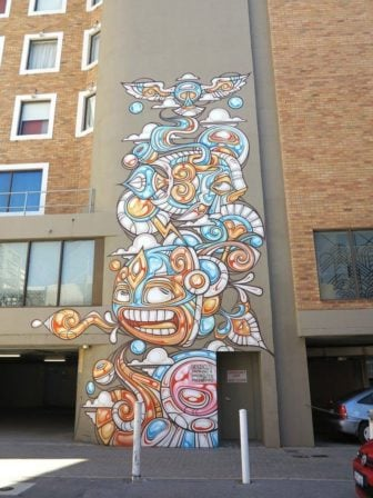 Cartoon animals frolic with elements of nature in this tribal street art painting by graffiti artist Phibs