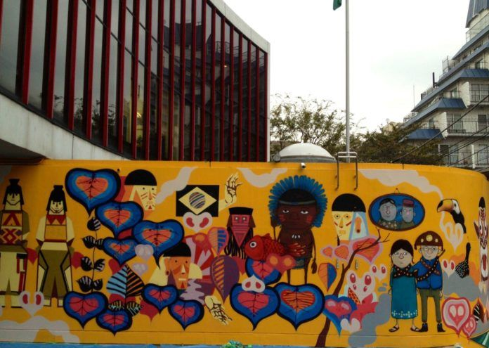 South American figures and styles are apparent in this street art mural by Titi Freak