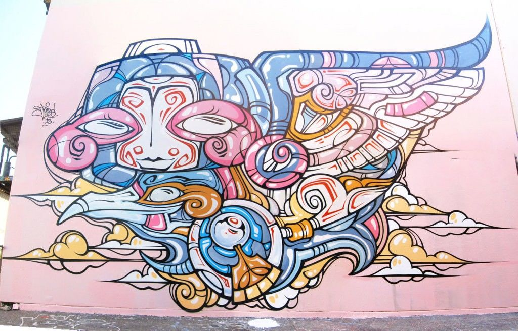 Street artist phibs shares the love in this cheerful for Cartoon mural painting