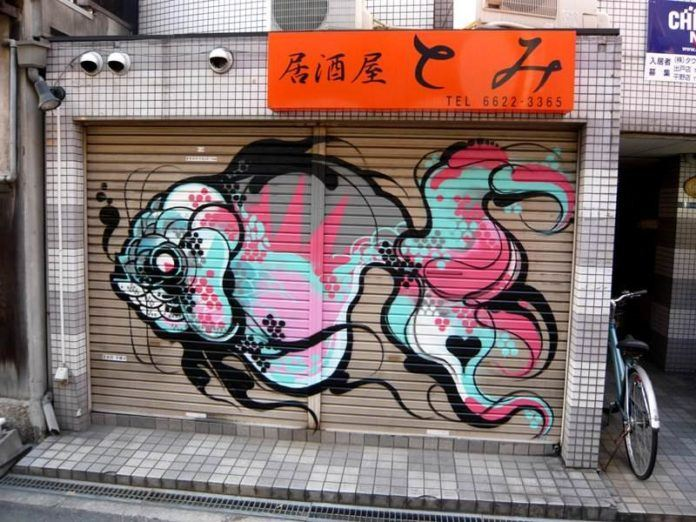 Street artist Titi Freak gives a fantail goldfish a Japanese twist