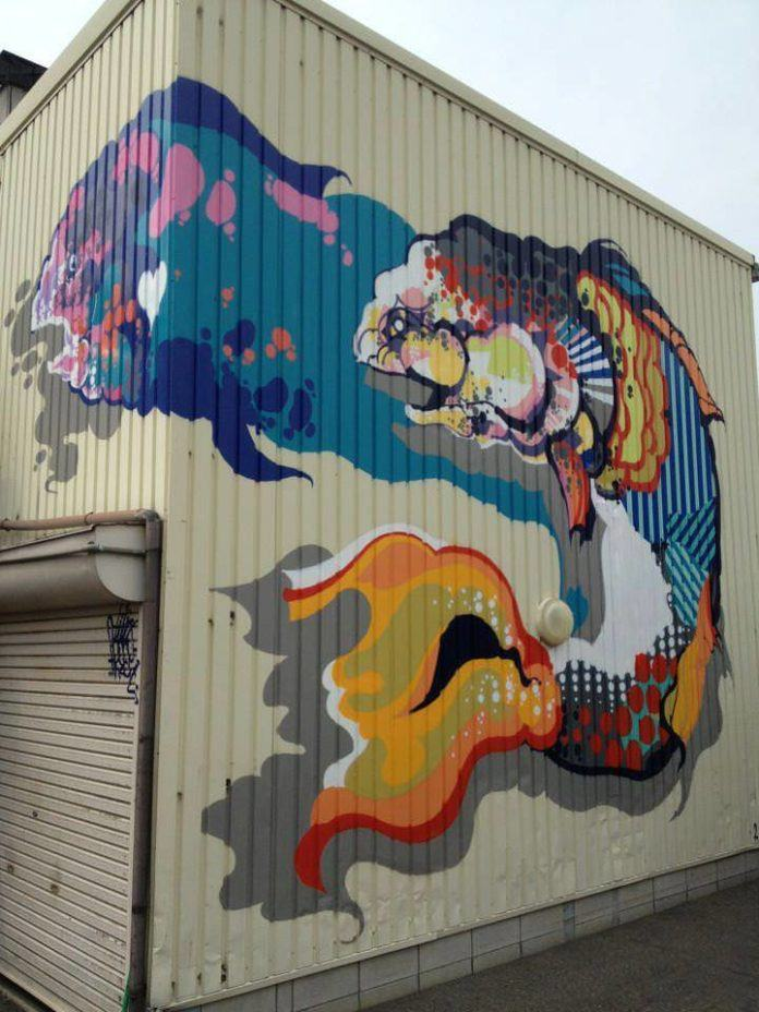 Street artist Titi Freak gives this mural of two fish texture with geometric shapes and patterns