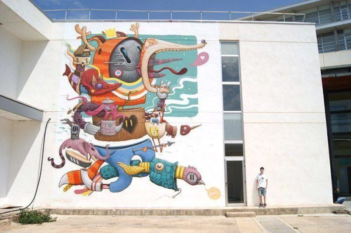 The finished street art mural called Bipolar by pop surrealist street artist Dulk