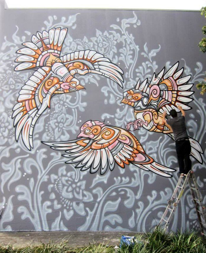 Three gorgeous tribal birds frolic in this cartoon styled graffiti painting by street artist Phibs