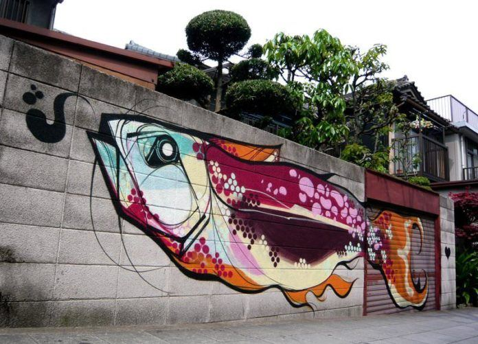 Titi Freak combines Japanese art styles with Brazilian colors in this street art mural of a giant fish