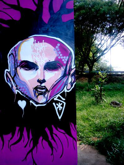 Titi Freak offers his unique art style to this street art portrait of a woman