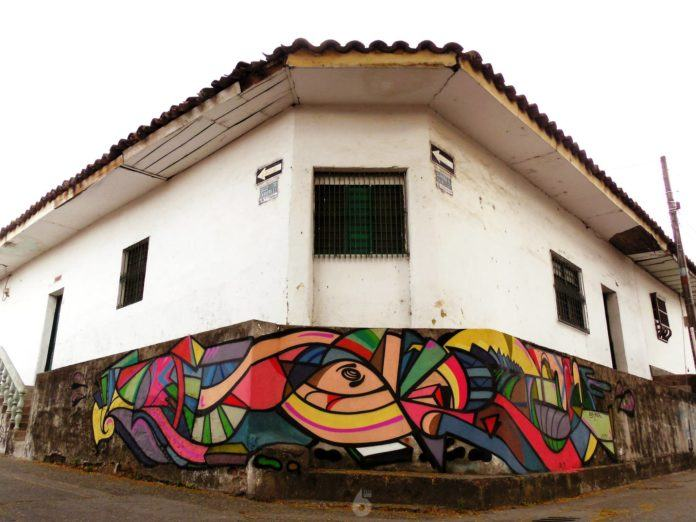 A run down street corner becomes a canvas for one of Anck Millan's uplifting graffiti murals