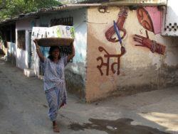 An Indian girl for a wall in India. Seth's street art characters reflect the country that he paints them in.