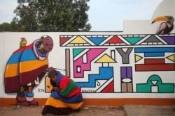 French graffiti muralist Seth collaborates with a local artist in South Africa to create a colorful African street art work