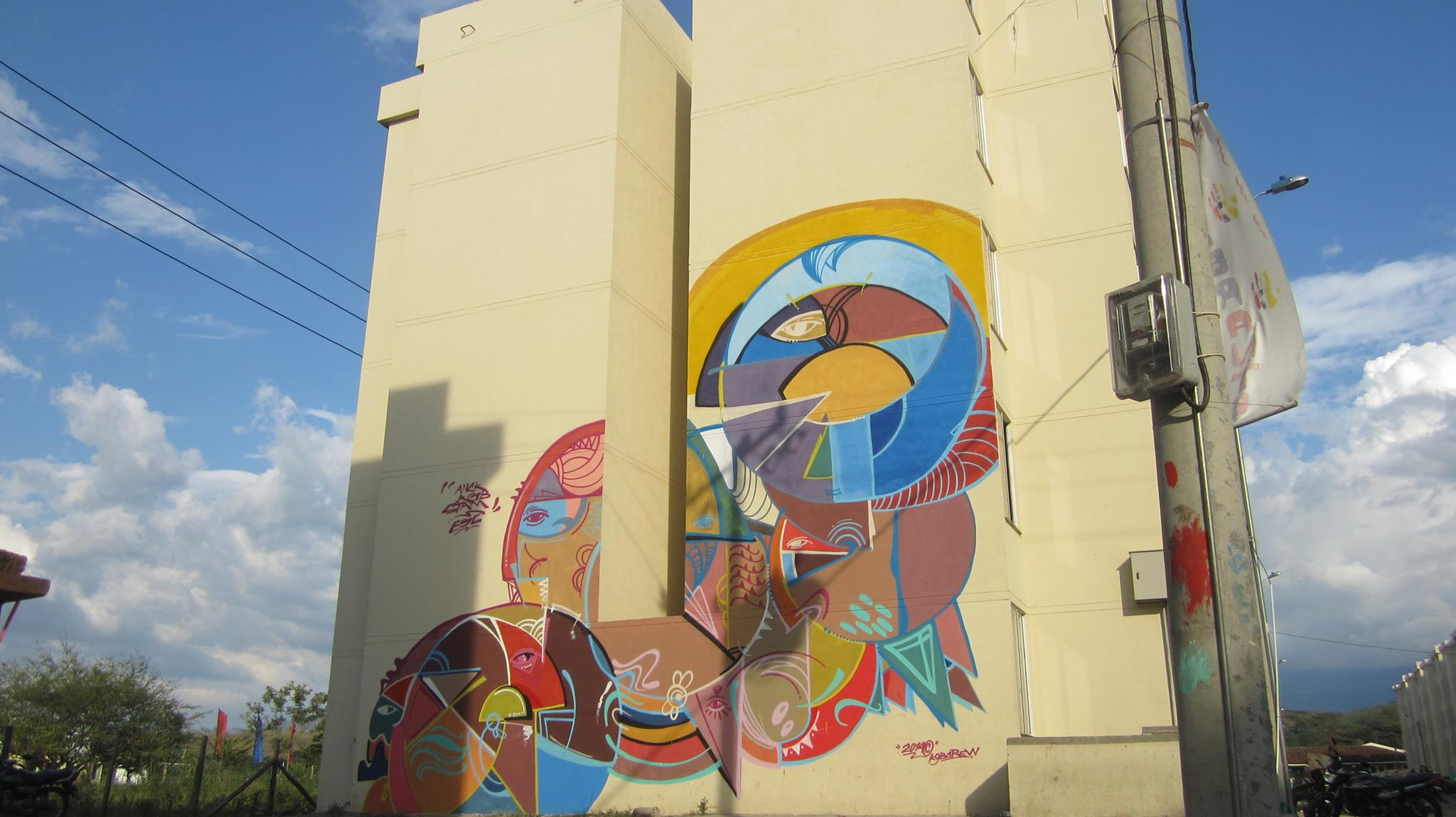 Geometric shapes create illusions of human faces in this large ... for Street Wall Art Illusions  589ifm
