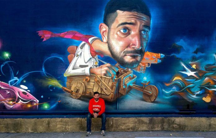Spanish street artist Belin travels to America to create this funny surrealist graffiti mural