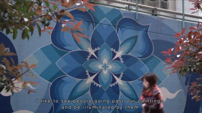 Kami and Sasu are a Japanese street art group who paint beautiful mandala flower wall murals; seen painted here in peaceful shades of sky blue and windy whites